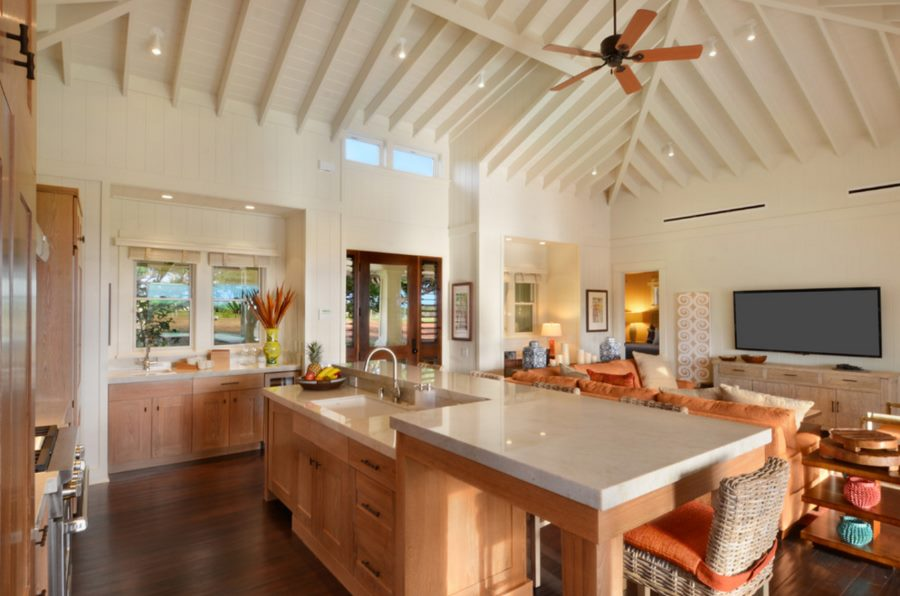 White ceiling spotlights in a kitchen with tropical accents