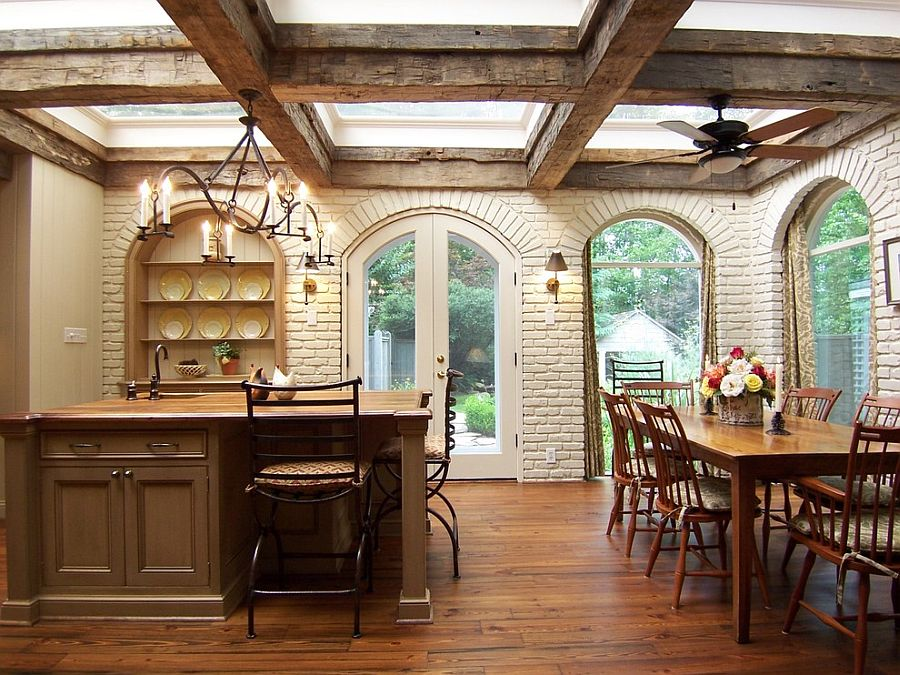Arched doors, windows and brick walls give the traditional kitchen a Mediterranean vibe [Design: Brian Patterson Designs]
