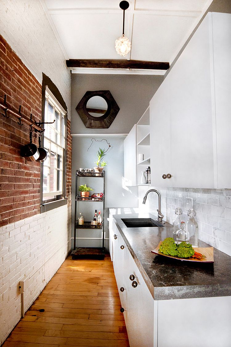 Fabulous way of creating different visual sections in the kitchen with a brick wall [Design: Landing Design]