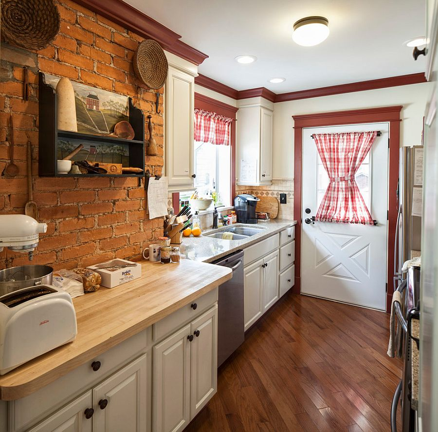 Farmhouse kitchen with antique shelf and brick wall backdrop [Design: Handy Home Guys]