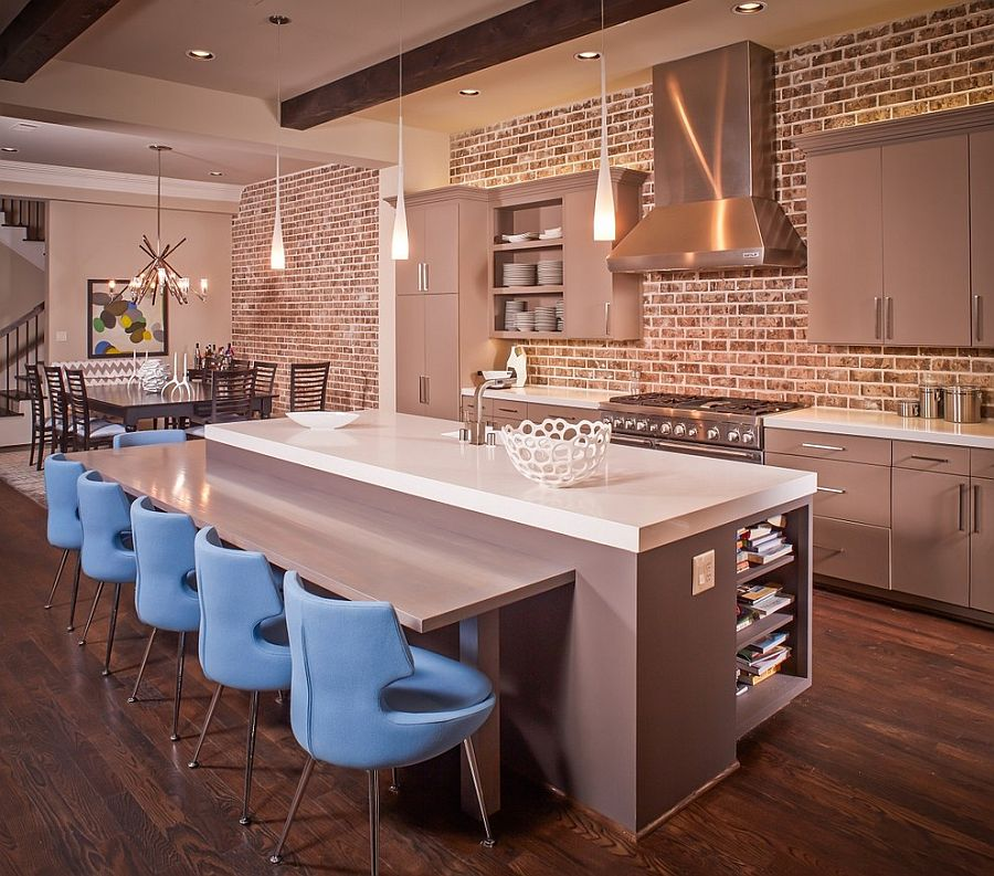 Gorgeous gray cabinets and kitchen island in kitchen with beautiful brick wall [Design: Jamestown Estate Homes]