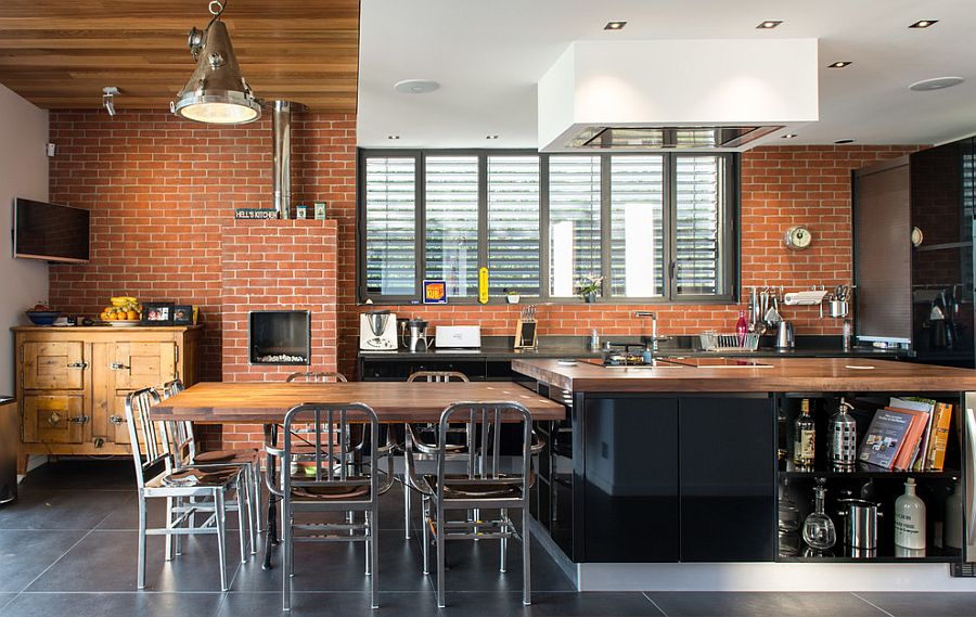 Innovative design of the kitchen island also offers a brilliant dining space [Design: architecture et bois]