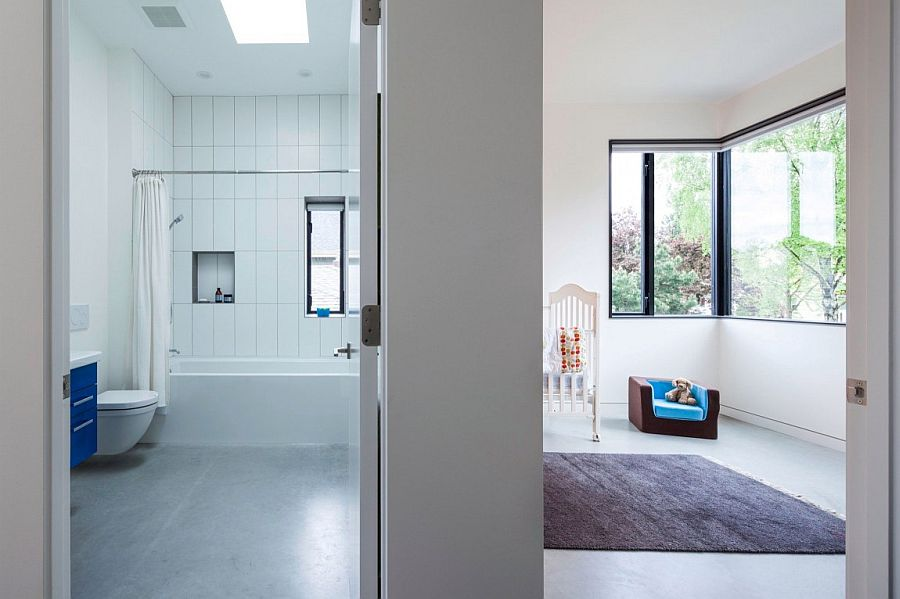 Kids' room and bathroom of the economical Vancouver home in white