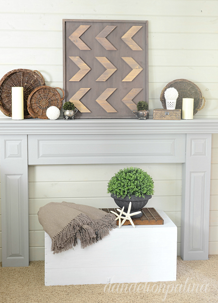 Rustic arrow art for a fireplace mantel