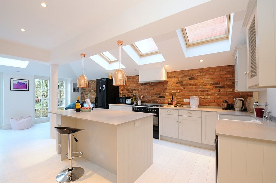 Scandinavian kitchen with gorgeous brick backsplash [Design: Affleck Property Services]