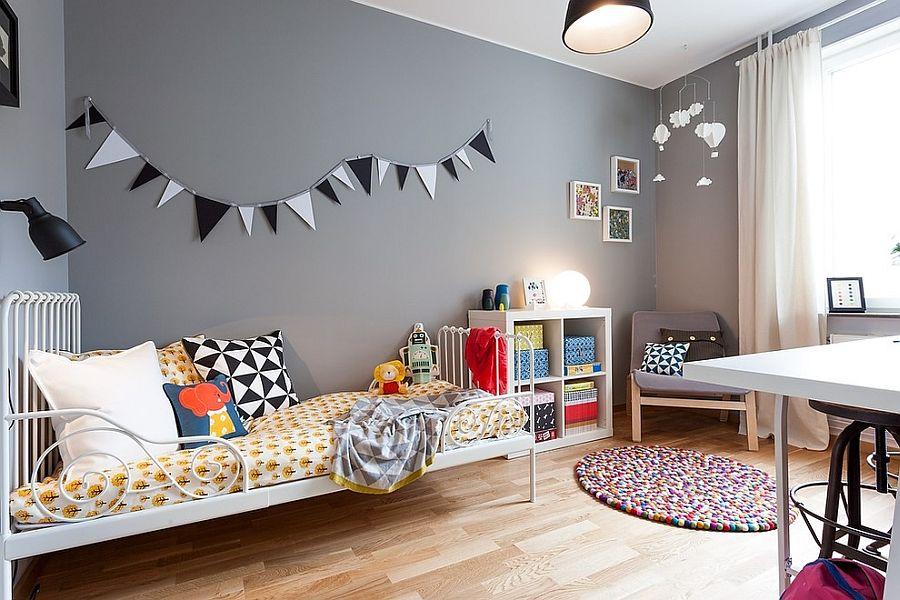 Scandinavian style kids' room with an unassuming gray backdrop [Design: Moodhouse Interiör]