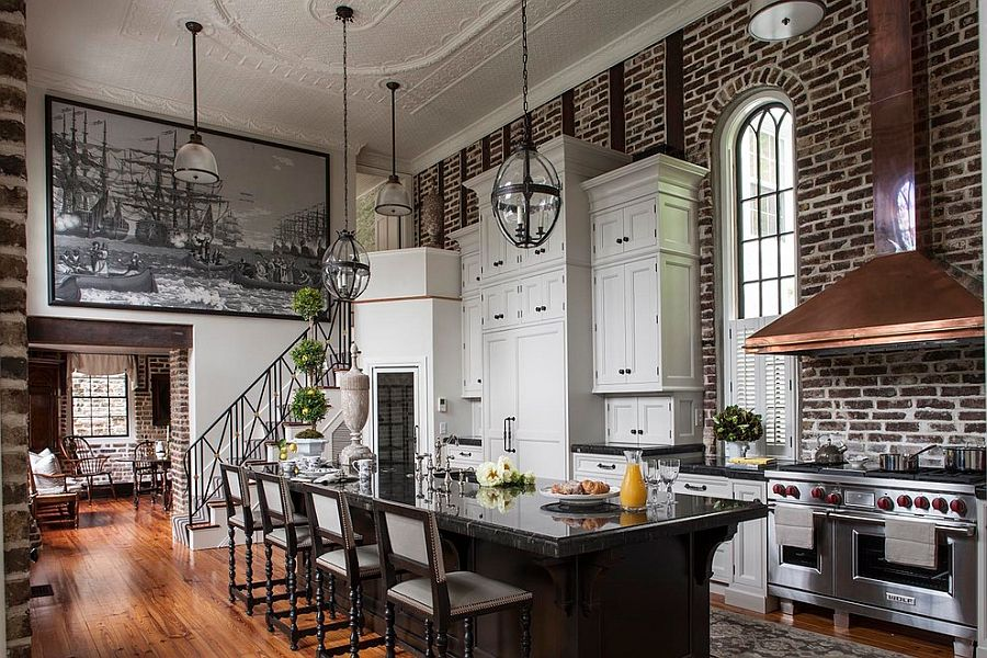 Sweeping Victorian kitchen with high ceiling, brick wall backdrop and an air of dramatic flair [Design: SLC Interiors]