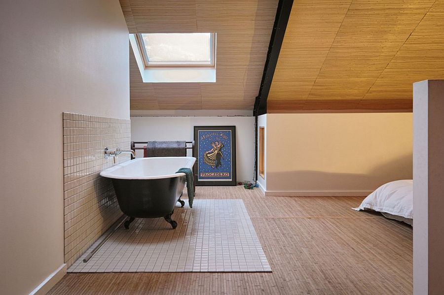 Bathtub in the corner of the upper level master bedroom