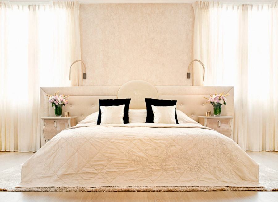 Cream draperies in an elegant bedroom