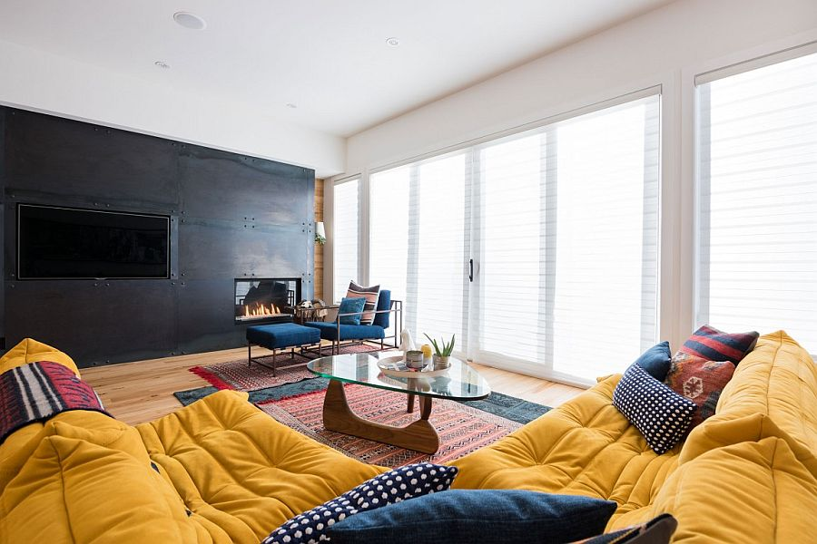 Dark accent wall in the living space with TV and fireplace