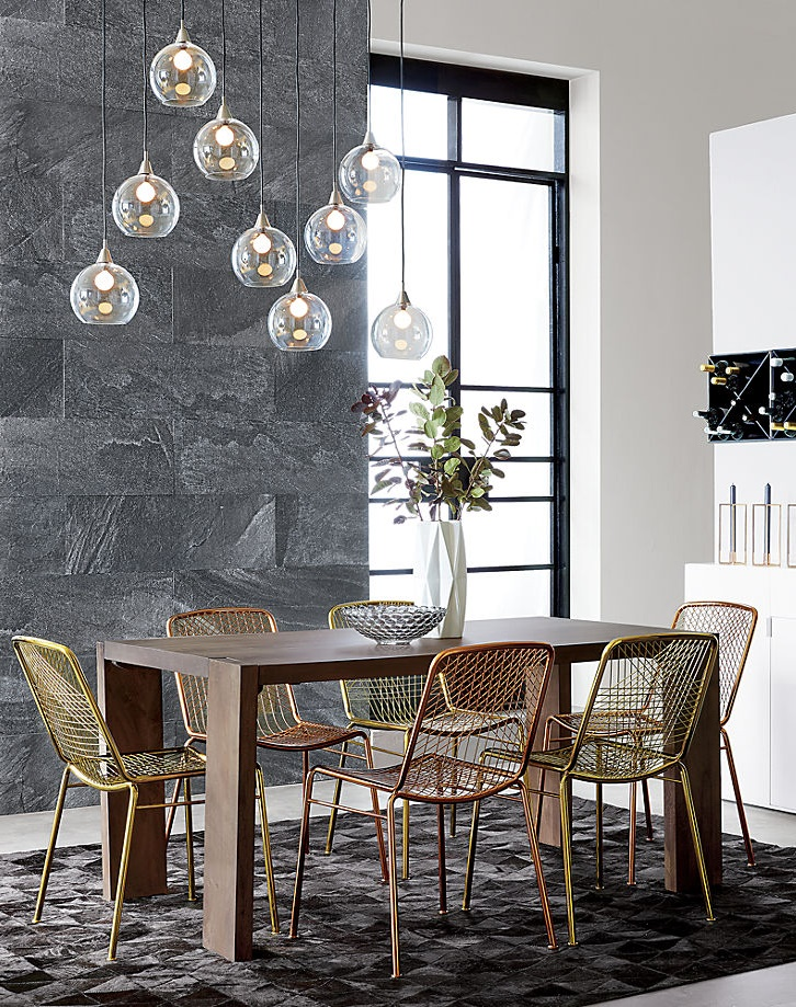Dining table with mixed metal chairs from CB2