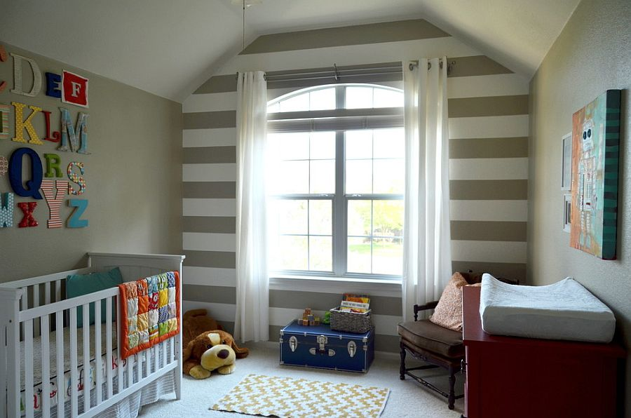 Elegant nursery for a baby boy with striped feature wall