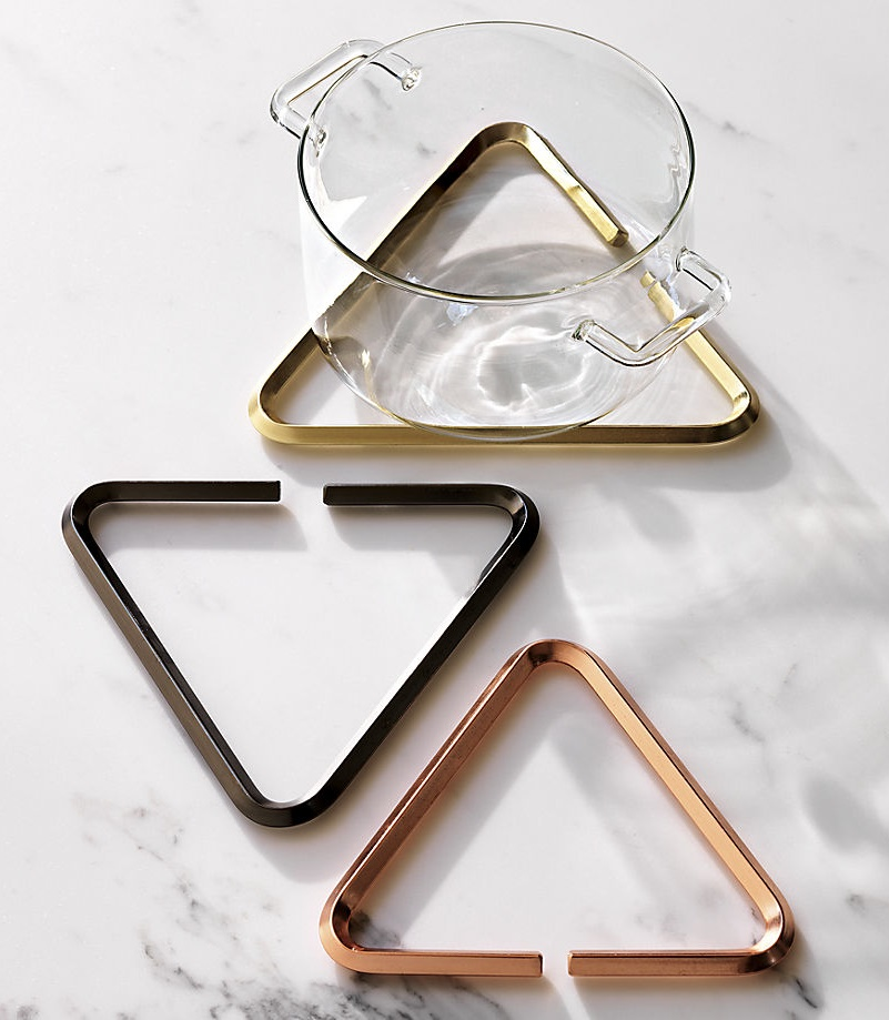 Metal trivets in black, rose gold and brass tones from CB2