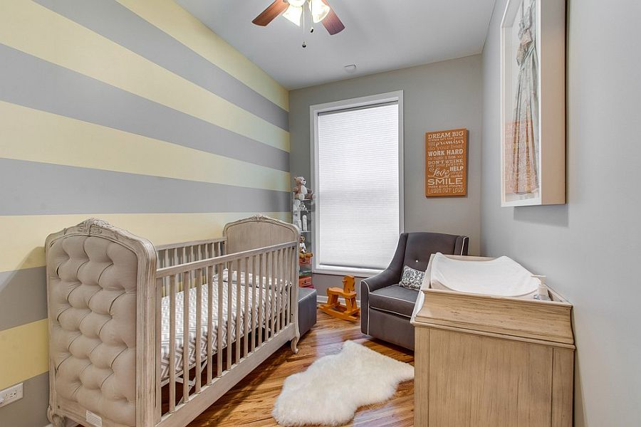 Small nursery design with striped accent wall