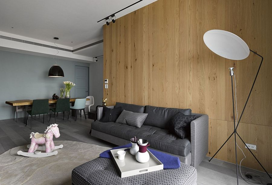 Wooden wall adds textural elegance to the small interior