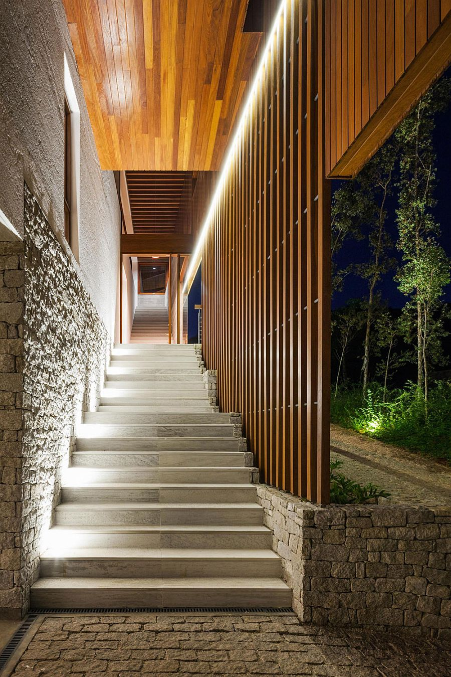 Beautiful lighting illuminates the stairway leading to the Brazilian home