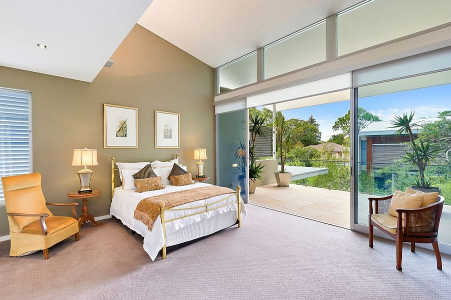 Bedroom on the top level with a view of the courtyard