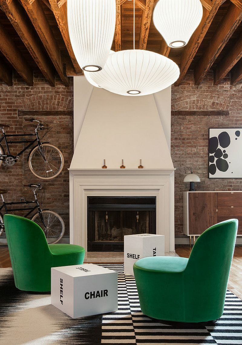 Black and white rug and green velevt armchairs from IKEA in the living room