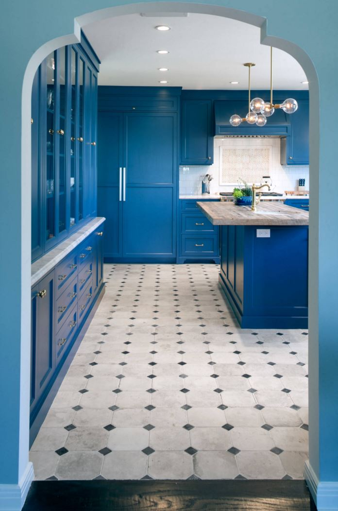 Blue walls introduce a kitchen with blue cabinets