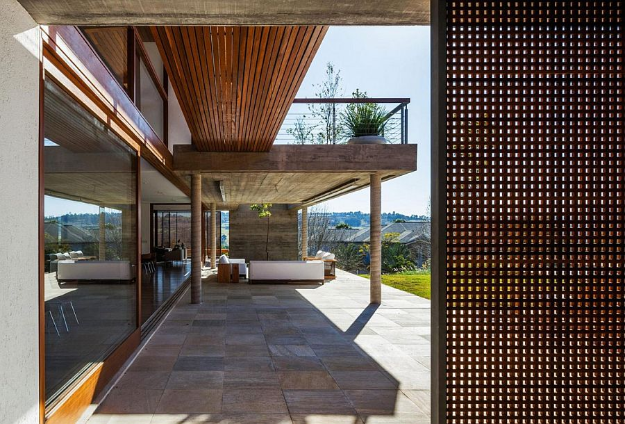 Concrete balcony acts a pergola for the loower level deck