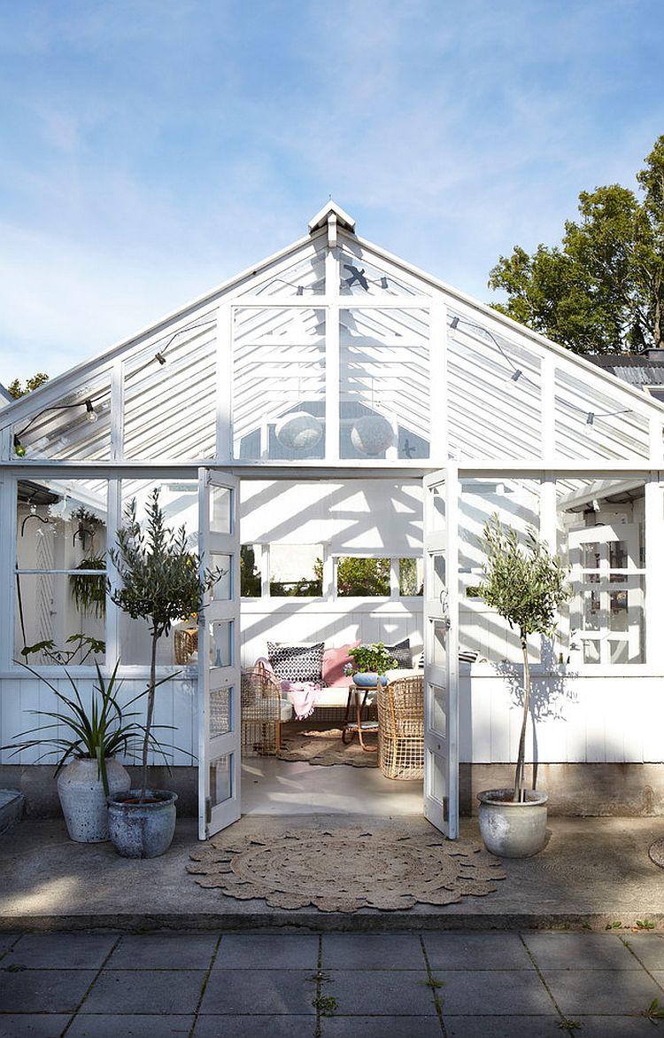 Elegant Scandinavian sunroom with a hint of farmhouse panache