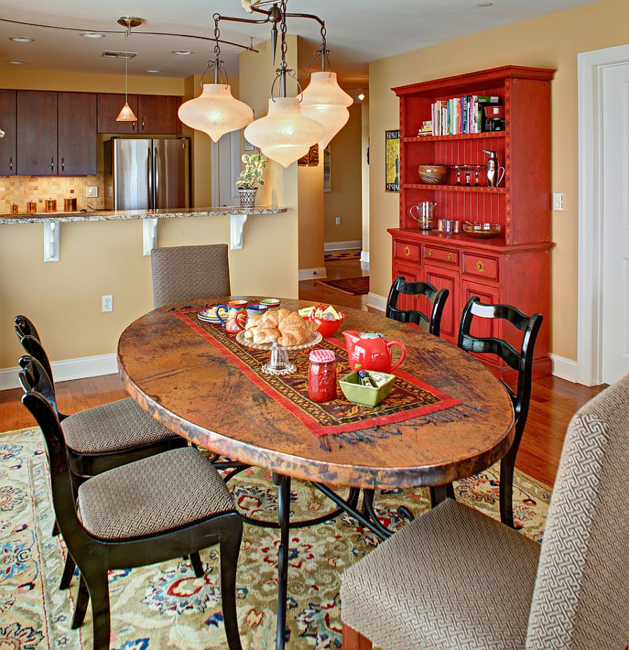 Fabulous dining room hutch adds red to the eclectic setting [Design: Tracey Stephens Interior Design]