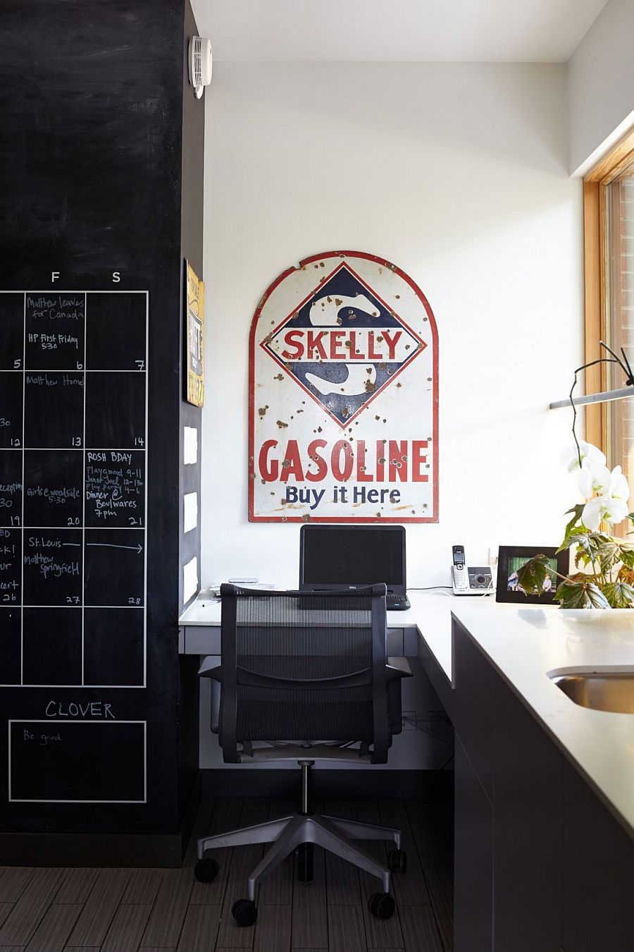 Home office with corner workspace and chalkboard wall