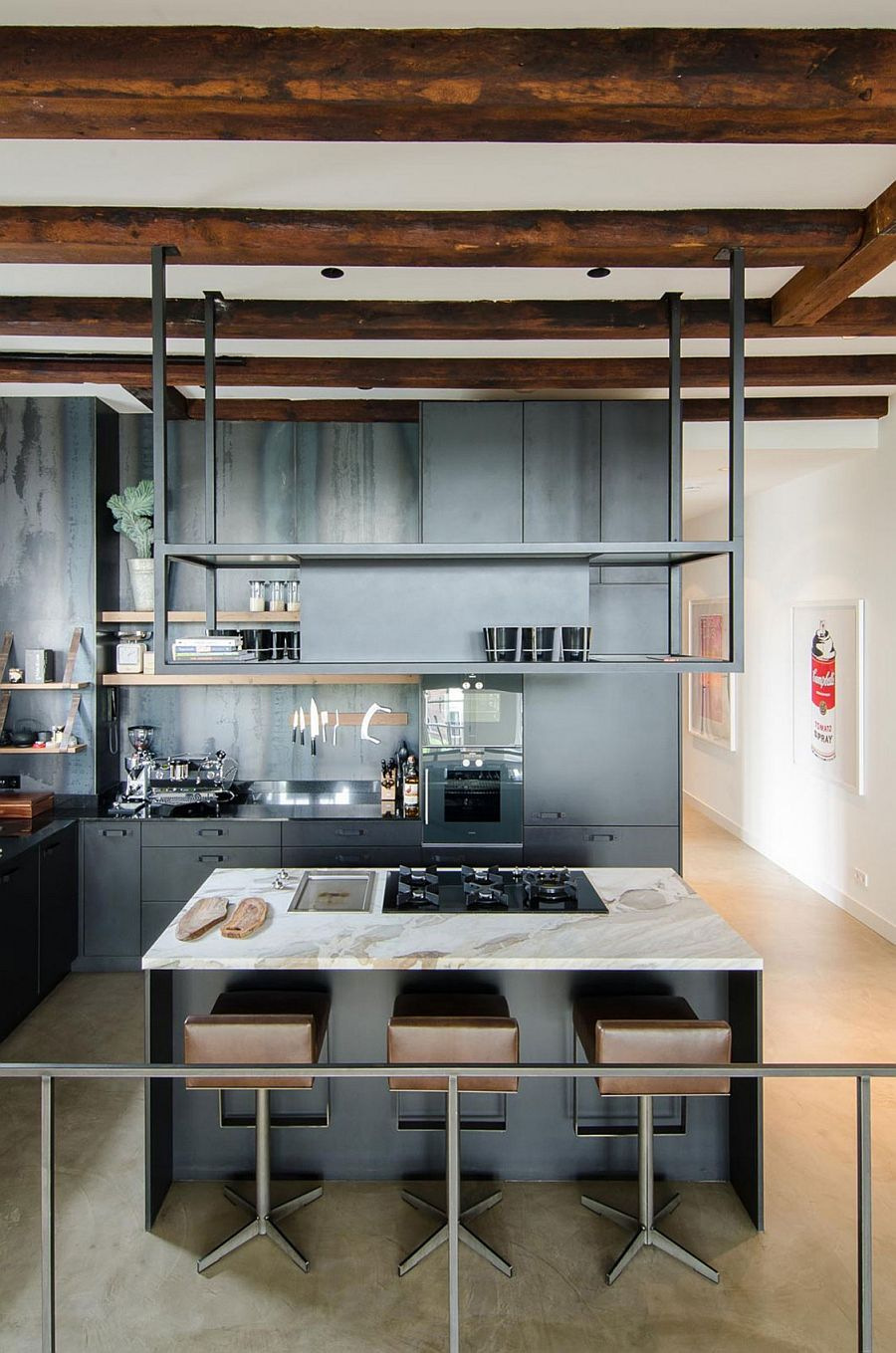 Industrial modern kitchen with exposed wooden beams and gray cabinets