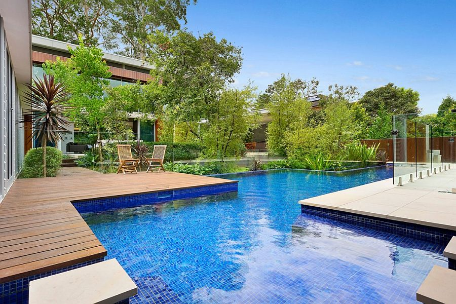 Large pool defines and becomes the focal point of the large yard