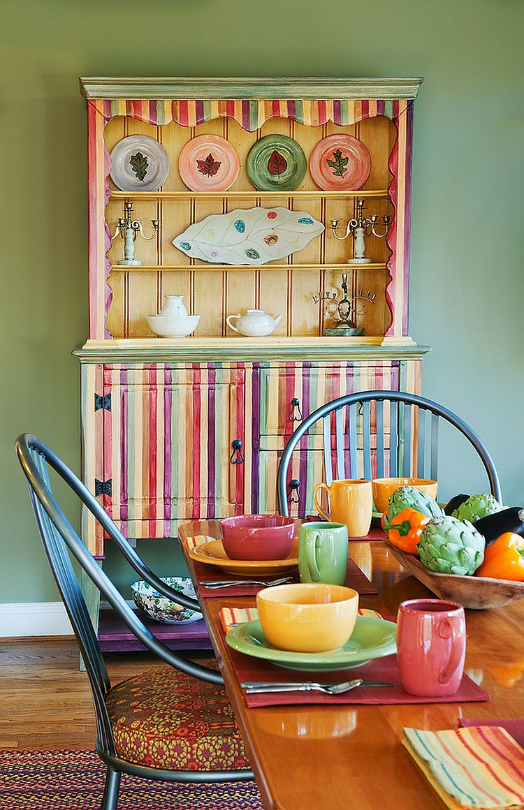 Multi-colored dining room hutch becomes a vivacious focal point in the dining room [Design: Carol Freedman Design]