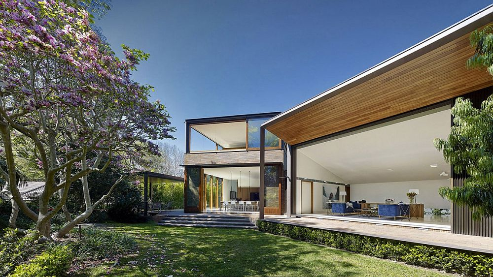 Open design of the home opens it up towards the lush green garden landscape