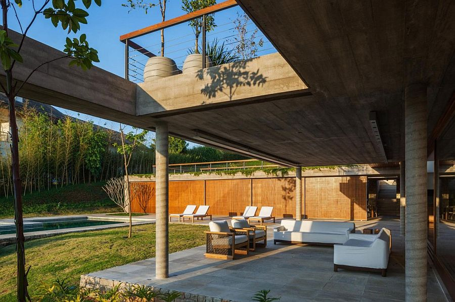 Outdoor sitting zone and poolside deck of the FT Residence