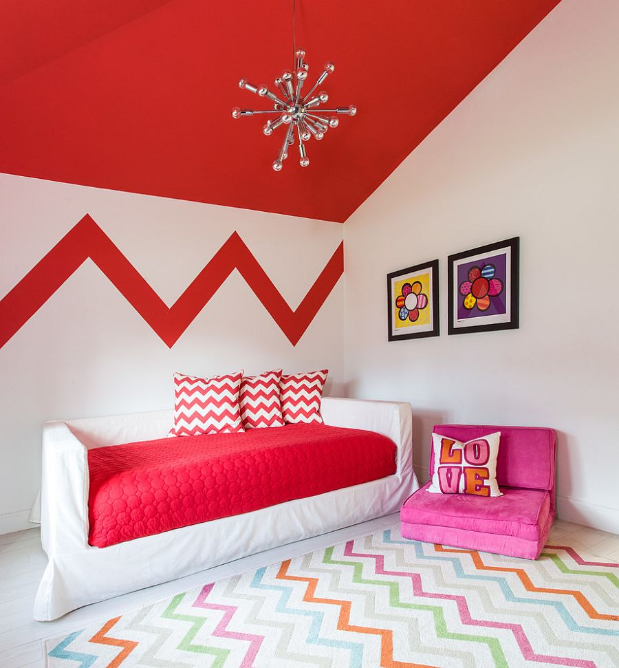 Rug, accent pillows and feature wall add chevron pattern to the stylish kids room