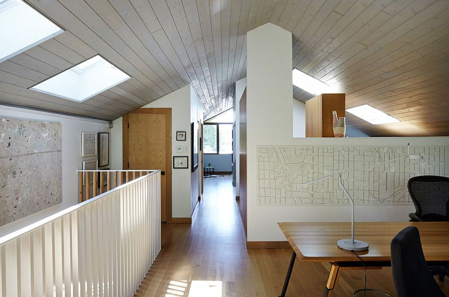 Skylights on the top level illuminate the walkways and home office