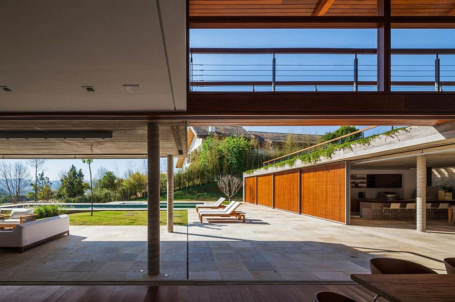 Sliding wooden doors connect the interior with the expansive courtyard