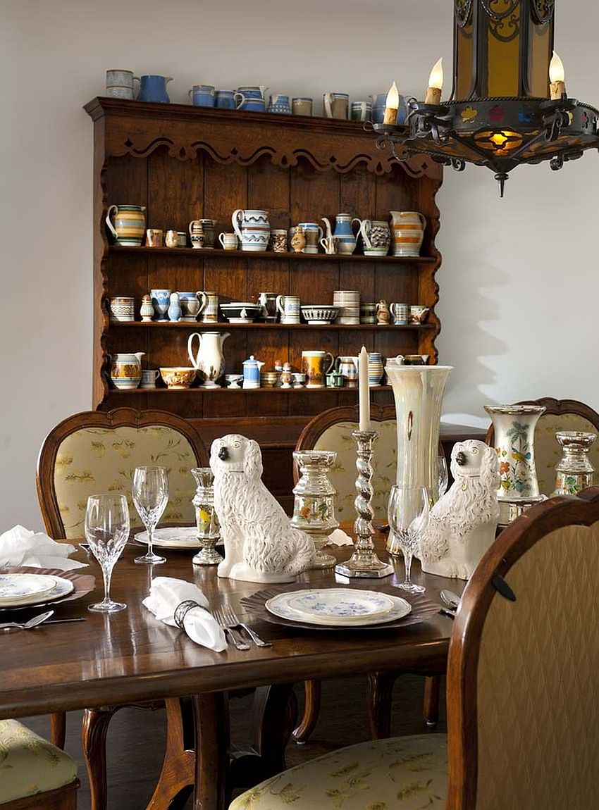 Spanish Colonial dining room with a beautiful hutch and lovely lighting [Design: Astleford Interiors]