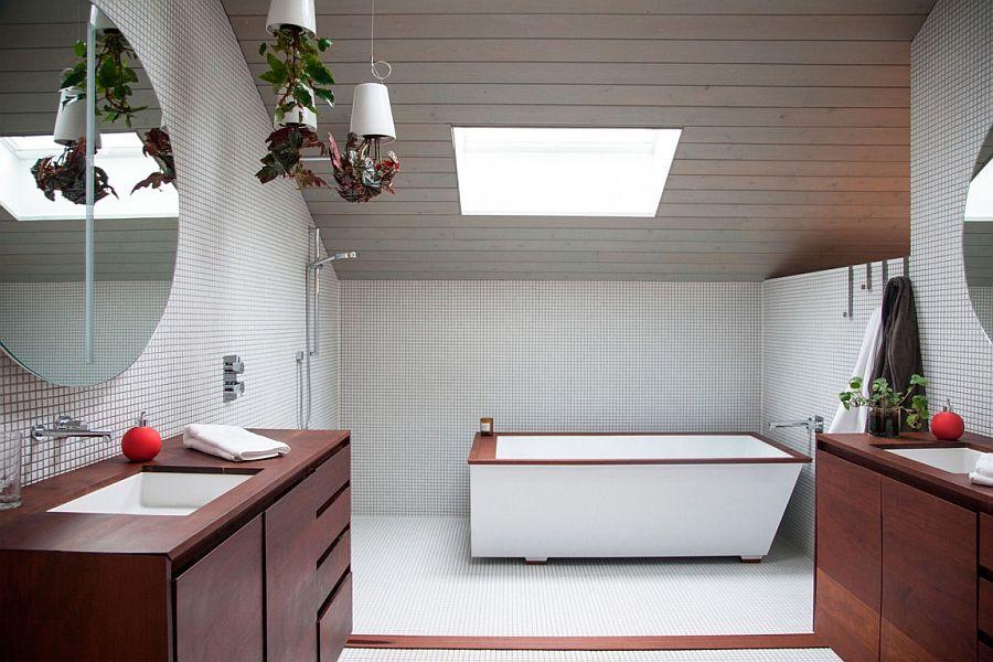 Stunning attic level bathroom with a skylight