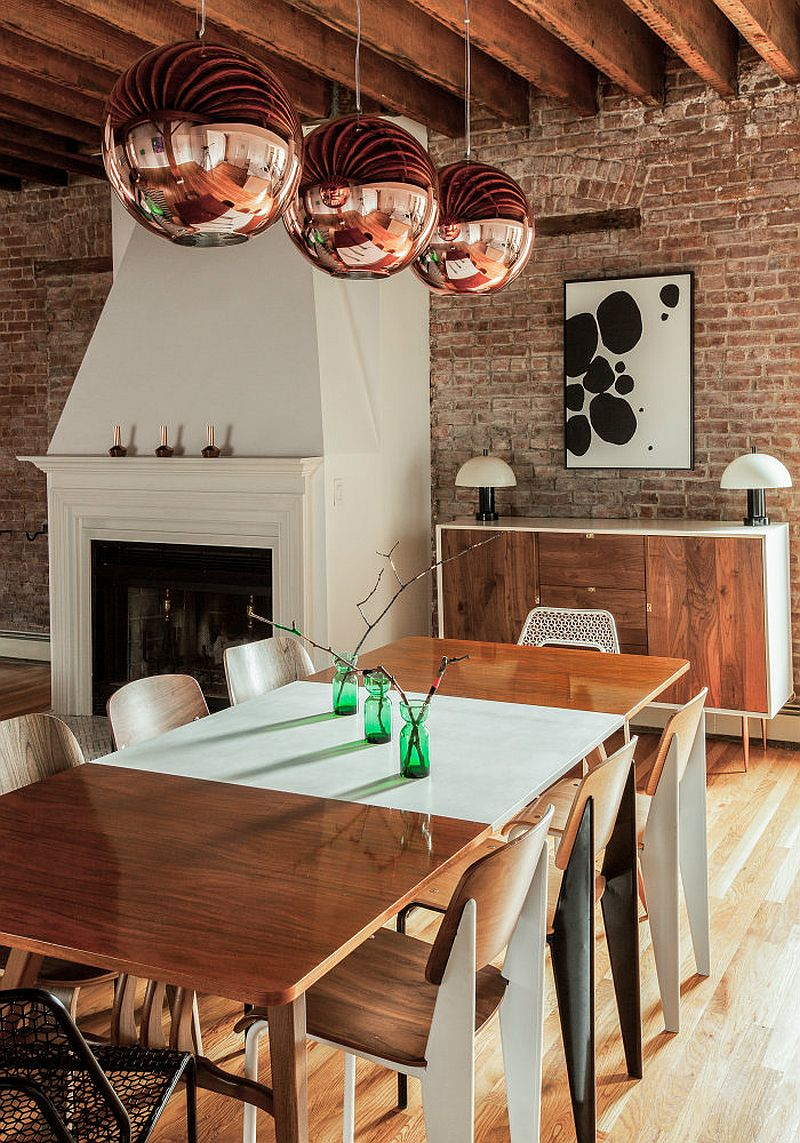 Tom Dixon pendant lights steal the show in the modern industrial dining room