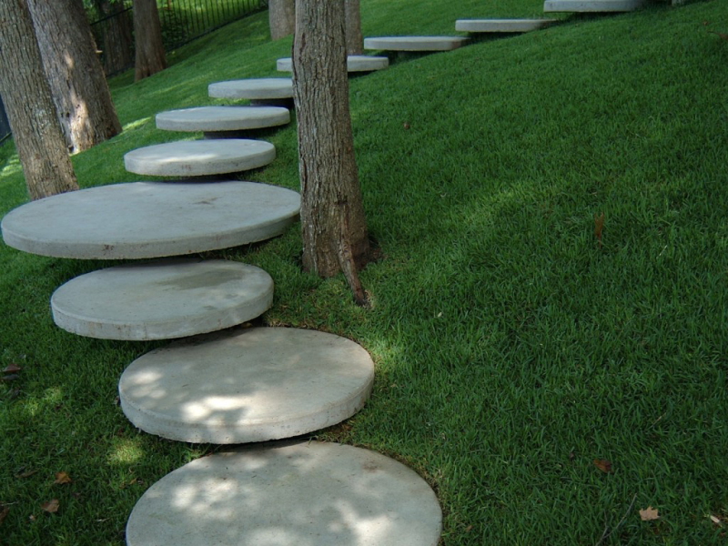 A sculptural staircase adds interest against a manicured lawn