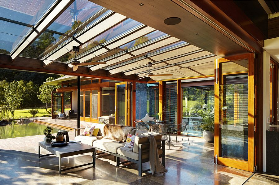 Asian sunroom with glass roof and retractable external shade blinds