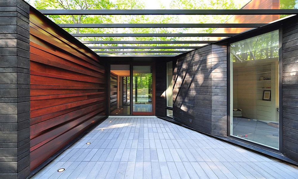 Carefully designed and shiny wall of milled lumber welcomes you at the Pleated House