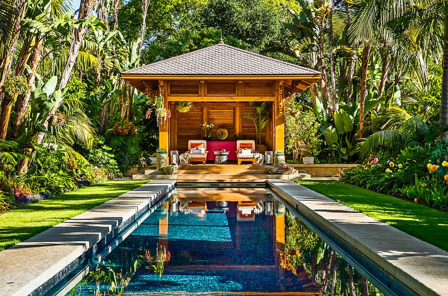 Fabulous tropical pool house and pool surrounded by lush tropical vegetation [Design: Neumann Mendro Andrulaitis Architects]