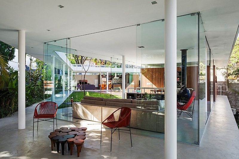 Glass walls completely open up the interior to the landscape outside