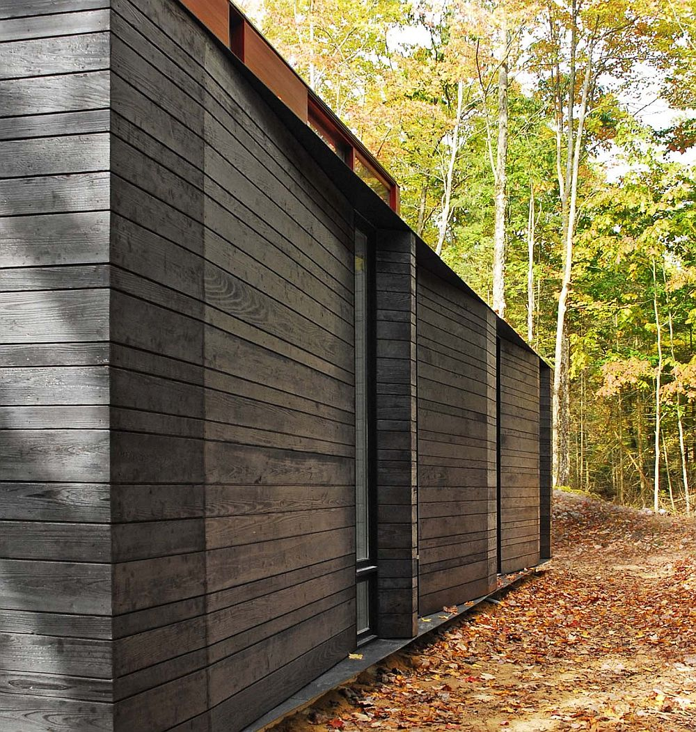 Gorgeous charred cedar siding allows the home to disspear into the forest at night
