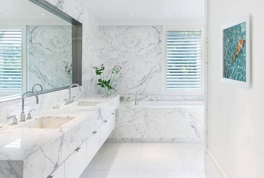 Indulgent contemporary bathroom in white with marble vanity and walls