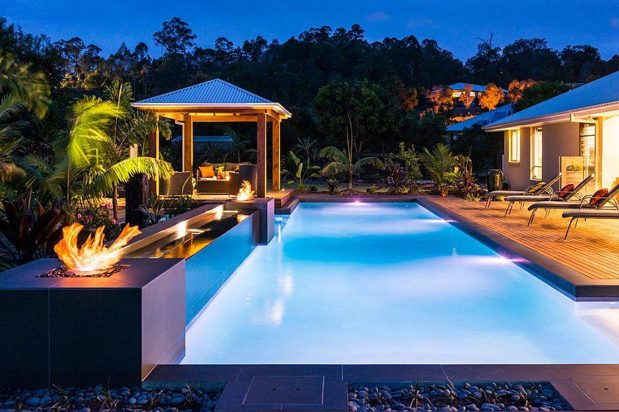 Mesmerizing pool and deck with fire pits and a relaxing outdoor lounge