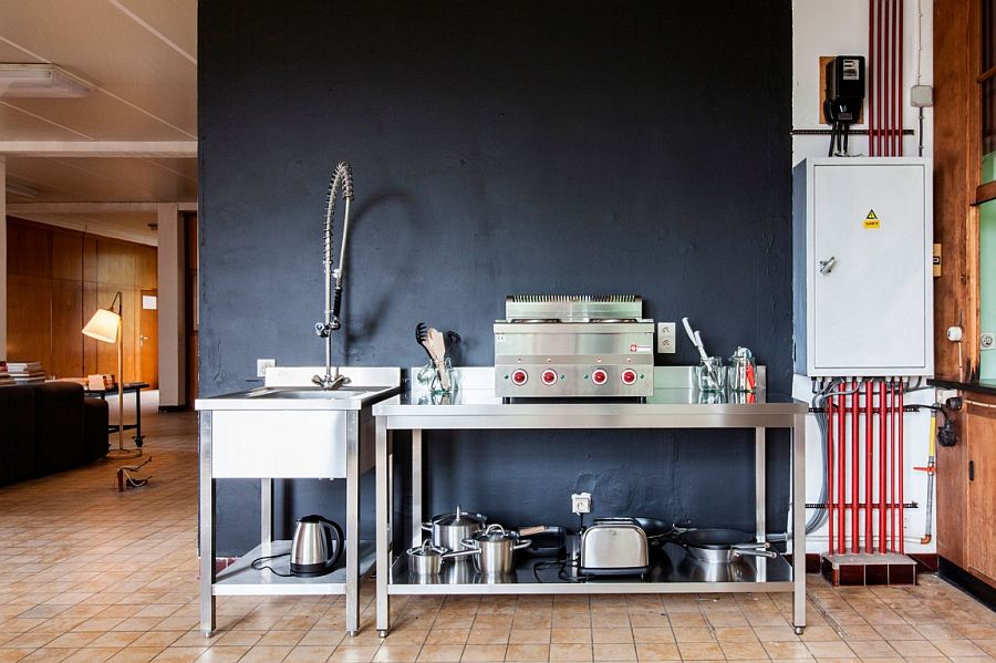 Metal kitchen sink and workstation with an unassuming industrial style