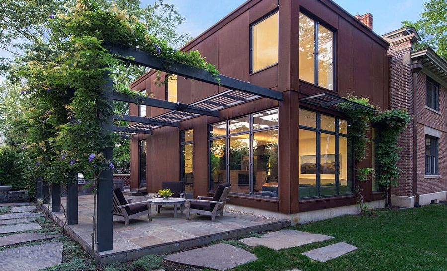 Modern cor-ten steel and glass extension for classic Fayerweather Street Residence