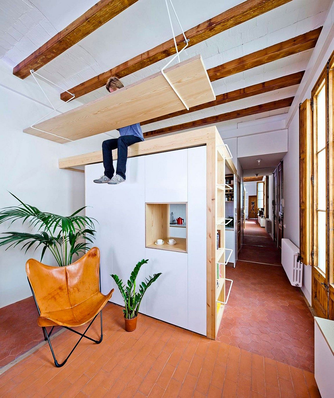 Open plan living area and kitchen of the Barcelona apartment makes use of vertical space