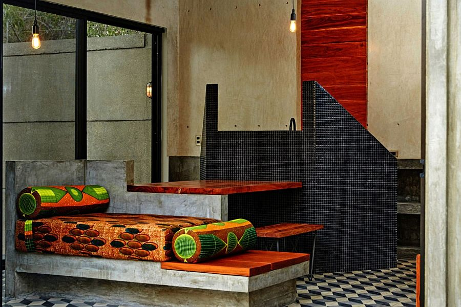 Polished cement also shapes the benches, tables and daybeds indoors